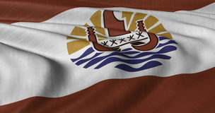 Französisch-Polynesien-Flagge, die in der leichten Brise flattert Lizenzfreie Stockfotografie