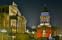 Französischer Dom. Schauspielhaus and Französischer Dom at the Gendarmenmarkt in Berlin at night Royalty Free Stock Images