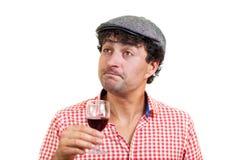 Französischer Mann, der etwas Wein schmeckt Lizenzfreies Stockfoto