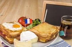 Französisches Frühstück und leere Tafel Lizenzfreies Stockfoto