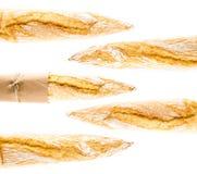 Französisches krustiges Stangenbrot des Vollweizenbrotes auf einem weißen backgrou Stockfotografie