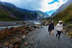 FRANZ JOSEF GLACIER NEW ZEALAND - SEP4,2015 : unidentified tourist trekking in franz josef glacier natural trail ,franz josef is. Most popular traveling stock image