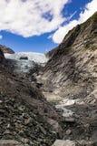 Franz Josef Glacier in New Zealand. Franz Josef Glacier in the South Island of New Zealand with edge of glacier through the rocks Stock Image