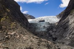 Front of the Franz Josef Glacier in New Zealand. Franz Josef Glacier in the South Island of New Zealand in retreat from the coast Royalty Free Stock Images