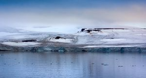 Franz Josef Land - glaciers. 900 km from North Pole. Franz Josef Land - glaciers in Strait of Booth and American Strait. Front wall of glacier, ablation area stock photography