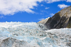Franz Joseph Glacier. View of Franz Joseph glacier with hikers in New Zealand, South Island Stock Image