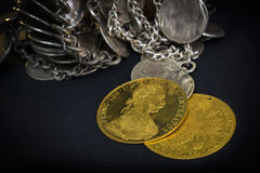 Franz Joseph I, Austro-Hungarian golden ducats from 1915 with silver jewelery Royalty Free Stock Photo
