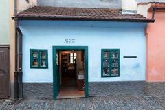 Franz Kafka`s tiny house on Golden Lane of the Prague Castle. PRAGUE, CZECH REPUBLIC - December 13, 2018: Franz Kafka lived and worked in this tiny brightly stock image