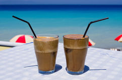 Frappe on the beach. Delicious frappe on the beach royalty free stock photos