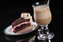 Frappuccino with cake. Served cold frappuccino with cake on black background Stock Photos