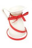 Frasco branco com a correia vermelha no fundo branco Fotografia de Stock Royalty Free