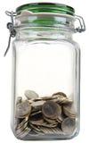 Frasco com moedas Fotografia de Stock