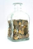 Frasco com moedas Fotos de Stock