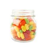 Frasco completamente dos doces do feijão de geleia isolados Foto de Stock