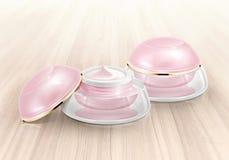 Frasco cosmético da abóbada cor-de-rosa na madeira Foto de Stock