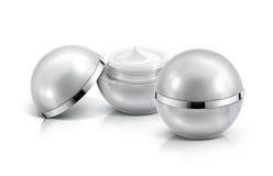 Frasco cosmético da esfera dois de prata no branco Imagem de Stock Royalty Free