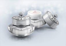 Frasco cosmético de luxe de prata no brilho Foto de Stock Royalty Free