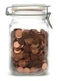Frasco das moedas de um centavo Fotografia de Stock Royalty Free