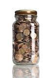 Frasco das moedas de um centavo Fotografia de Stock