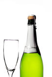 Frasco de Champagne com vidro vazio Fotografia de Stock Royalty Free