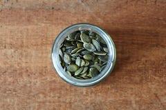 Frasco de sementes de abóbora Fotografia de Stock Royalty Free