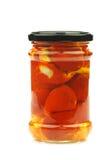 Frasco de vidro com pimentas doces pequenas vermelhas Fotografia de Stock Royalty Free