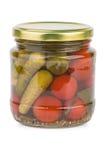 Frasco de vidro com tomates e cornichons conservados Fotografia de Stock