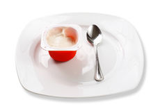 Frasco do iogurte na placa Imagem de Stock Royalty Free