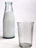 Frasco do leite Fotos de Stock