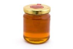 Frasco do mel sobre o branco Fotografia de Stock Royalty Free