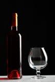 Frasco do vinho e do vidro vazio Imagens de Stock