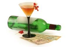Frasco do vinho e dos dólares Foto de Stock Royalty Free