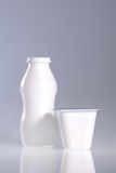 Frasco e copo plásticos Imagens de Stock Royalty Free
