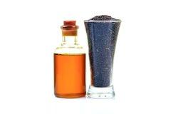 Frasco e sementes de petróleo da mostarda Imagem de Stock