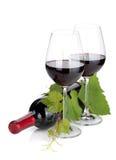 Frasco e vidros de vinho vermelho Imagem de Stock