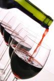 Frasco e vidros de vinho vermelho Imagens de Stock