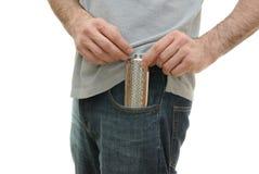 Frasco en el bolsillo del individuo Imagen de archivo libre de regalías