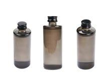 Frasco negro de la botella de cristal aislado Imágenes de archivo libres de regalías