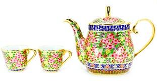Frasco tailandês do chá e dois copos Fotos de Stock