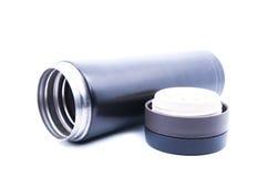 Frasco termo negro sobre el fondo blanco Foto de archivo libre de regalías