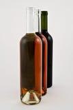 Frascos brancos e cor-de-rosa vermelhos do vinho Imagem de Stock Royalty Free