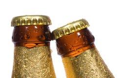 Frascos da cerveja com gotas da água Fotos de Stock Royalty Free