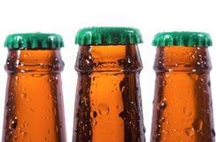 Frascos da cerveja com gotas da água Foto de Stock Royalty Free