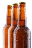 Frascos de cerveja no fundo branco Imagens de Stock