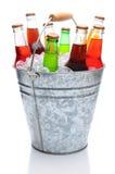 Frascos de soda Assorted na cubeta de gelo Fotos de Stock Royalty Free