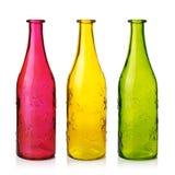 Frascos de vidro coloridos vazios Imagens de Stock