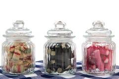 Frascos de vidro dos doces no azul Imagens de Stock