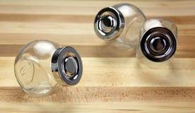 Frascos de vidro em um fundo de madeira Imagem de Stock Royalty Free