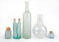 Frascos de vidro no branco Foto de Stock