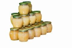 Frascos do mel no contador Imagens de Stock Royalty Free